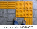 shoes on block tactile paving... | Shutterstock . vector #663046525
