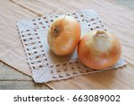 onions on a lace napkin. beige...