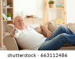 fat senior man watching tv... | Shutterstock . vector #663112486