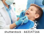 dentist examining little boy's... | Shutterstock . vector #663147166