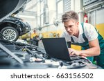 young mechanic in a garage | Shutterstock . vector #663156502