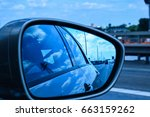 reflection in side mirror of a... | Shutterstock . vector #663159262