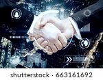 close up of handshake on night... | Shutterstock . vector #663161692