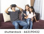 happy asian family at home... | Shutterstock . vector #663190432