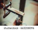 man using the drill makes a... | Shutterstock . vector #663208096