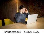 handsome man working at laptop... | Shutterstock . vector #663216622