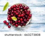 fresh cherry on plate on wooden ... | Shutterstock . vector #663273808