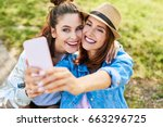 carefree joyful young woman... | Shutterstock . vector #663296725