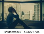 depressed man sitting head in... | Shutterstock . vector #663297736