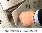 Businessman Unlocking Safe