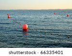 Several Red Buoys On Calm Sea...