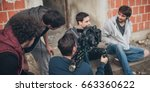 Behind the scene. Actor in front of the camera on the film set outdoor location. Group movie scene - stock photo