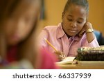 young girl working in classroom | Shutterstock . vector #66337939
