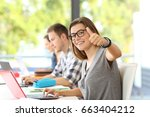 happy student wearing... | Shutterstock . vector #663404212