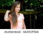 young teenage girl in the park... | Shutterstock . vector #663419566