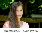 young teenage girl in the park... | Shutterstock . vector #663419626