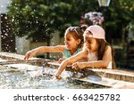 two little sisters playing in... | Shutterstock . vector #663425782