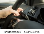 woman driving car and using... | Shutterstock . vector #663433246