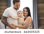 A Baby With Mother And Father...