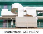 Small photo of air-cooled chillers and piping system in new building factory rooftop with blue sky background