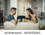 happy young couple sitting on... | Shutterstock . vector #663452662