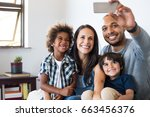 multiethnic family taking a... | Shutterstock . vector #663456376