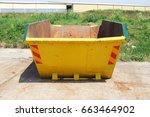 Small photo of Bright yellow skip landscape