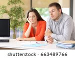 two bored customers waiting for ... | Shutterstock . vector #663489766