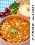 Small photo of Hot turkish bean stew with a tasty tomato sauce, Turkish Food; Kuru Fasulye.