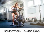 woman at the crossfit gym using ... | Shutterstock . vector #663551566