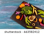 variety of raw green vegetables ... | Shutterstock . vector #663582412