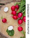 slices of fresh radishes  | Shutterstock . vector #663598342