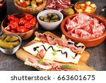 spanish tapas and sangria on... | Shutterstock . vector #663601675