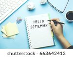 woman written hello september... | Shutterstock . vector #663642412