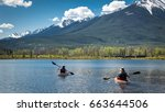two people are boating  kayaks...   Shutterstock . vector #663644506