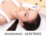 hands of cosmetologist making...   Shutterstock . vector #663678682