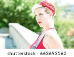 young blonde pinup girl with a...   Shutterstock . vector #663693562