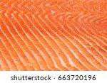fresh salmon fillet background | Shutterstock . vector #663720196