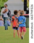 Small photo of TOWNSVILLE, AUSTRALIA - JUNE 06 2017: Spectators at Mabo Day Festival celebrating twenty-five years since historic High Court Mabo ruling recognising Indigenous Abor