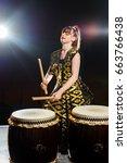 beautiful asian drummer girl...   Shutterstock . vector #663766438