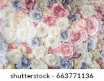 Stock photo backdrop of colorful paper roses background in a wedding reception with soft colors 663771136