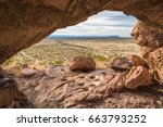 Small photo of Mortar holes fill a rock at the base of the Organ Mountains in Las Cruces, New Mexico.