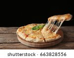 tasty sliced pizza with basil...   Shutterstock . vector #663828556