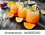 glasses of tequila sunrise... | Shutterstock . vector #663832342