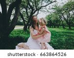 smiling mother and daughter... | Shutterstock . vector #663864526