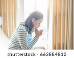 asian woman praying morning... | Shutterstock . vector #663884812