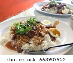 grilled pork rice with sauces | Shutterstock . vector #663909952