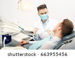 a young male dentist and a... | Shutterstock . vector #663955456