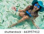 beautiful woman in bikini and... | Shutterstock . vector #663957412