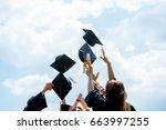 graduation caps thrown in the...   Shutterstock . vector #663997255